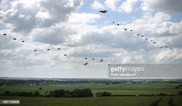 A parachute drop takes place on June 5 2014 near Ranville France Friday 6th June is the 70th anniversary of the DDay landings which saw 156000 troops...