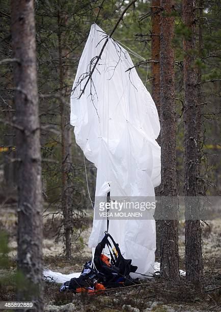 A parachute hangs from a tree close to the wreckage of a small airplane in a forest next to Jämijärvi Airfield southwest Finland on April 21 2014 The...