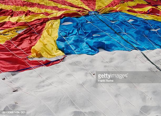 Parachute lying on beach