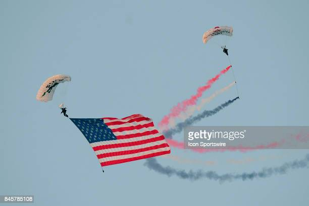 A parachute team delivers the American Flag to the field before the college football game between the Ohio Bobcats and the Purdue Boilermakers on...