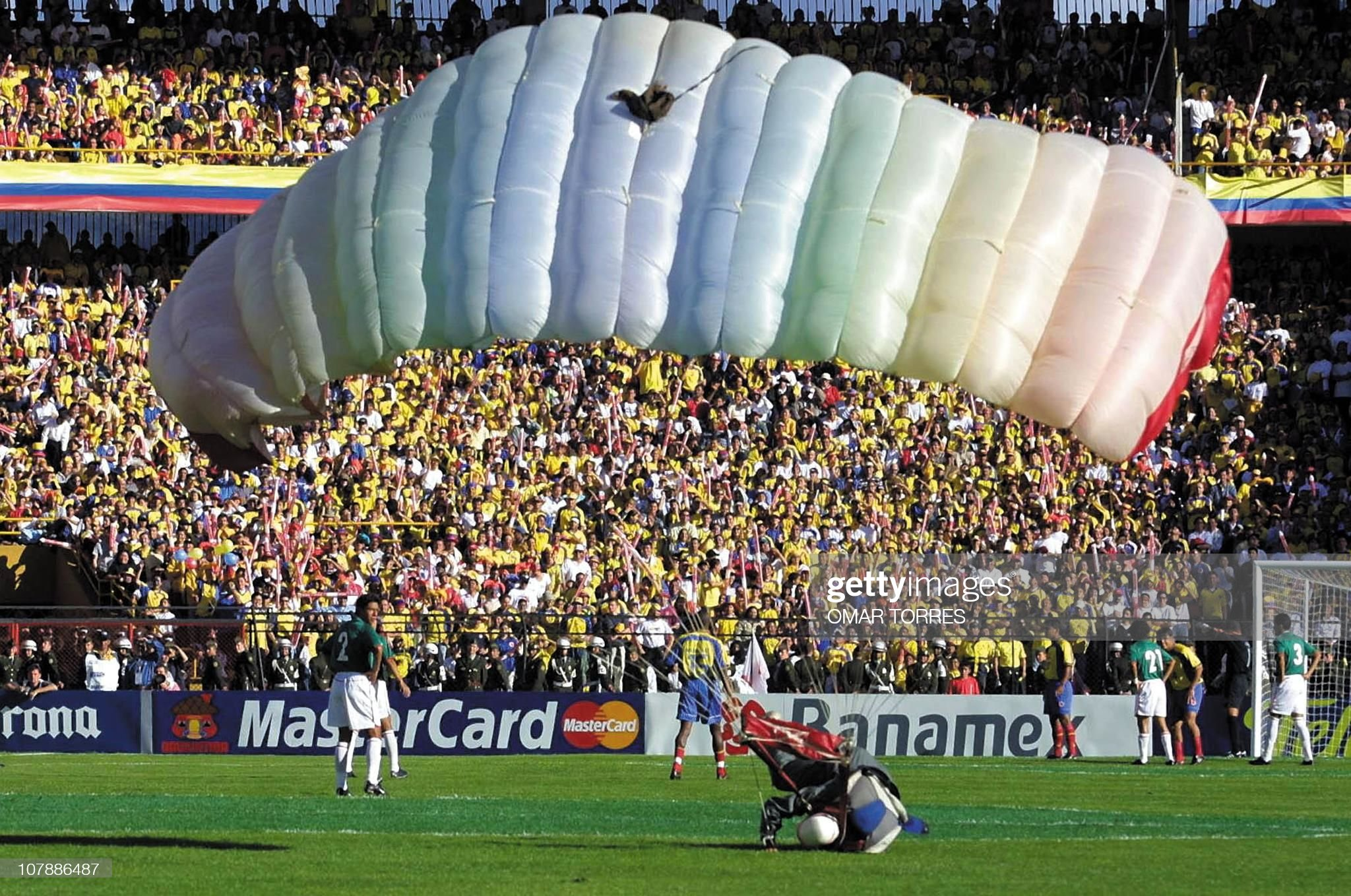A parachuter lands on the field in the N : News Photo