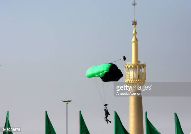 A parachuter performs during a military parade held to mark the National Army Day in front of the Mausoleum of Ayatollah Khomeini in Tehran Iran on...