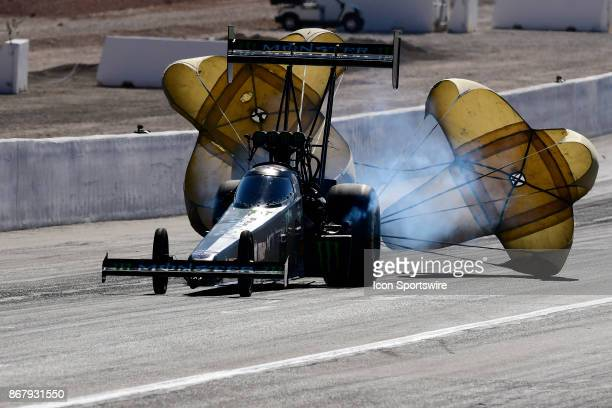 Parachutes deploy on the Brittany Force John Force Racing NHRA Top Fuel Dragster after a second round win in the 17th Annual Toyota Nationals,...