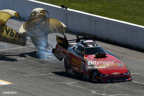 Parachutes open slowing Courtney Force John Force Racing Chevrolet Camaro SS NHRA Funny Car as smoke comes from under the car during the NHRA AAA...