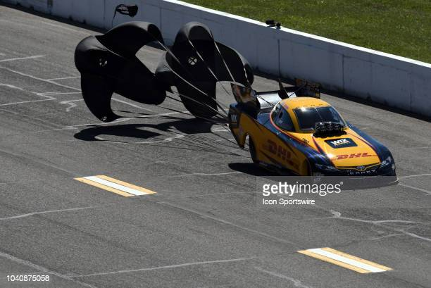 Parachutes open slowing JR Todd Toyota Camry NHRA Funny Car during the NHRA AAA Midwest Nationals on September 23 at Gateway Motorsports Park in...