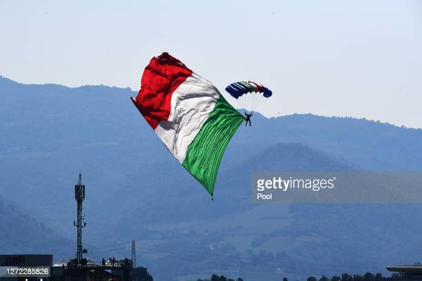 A parachutist displays a Italy flag over the circuit prior to the F1 Grand Prix of Tuscany at Mugello Circuit on September 13 2020 in Scarperia Italy