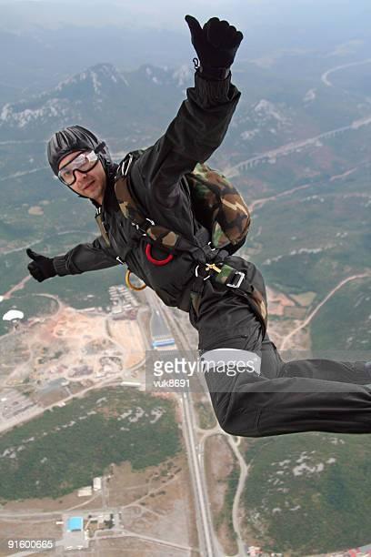 Parachutist in action