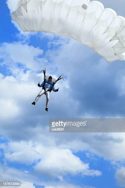 Parachutist in air