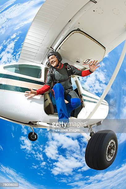 Parachutist jumping from airplane