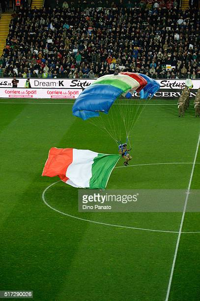 A parachutist lands at the stadium with Italy flag before the international friendly match between Italy and Spain at Stadio Friuli on March 24 2016...