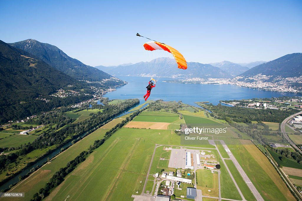 Parachutist under canopy flying high in the sky : Stock Photo