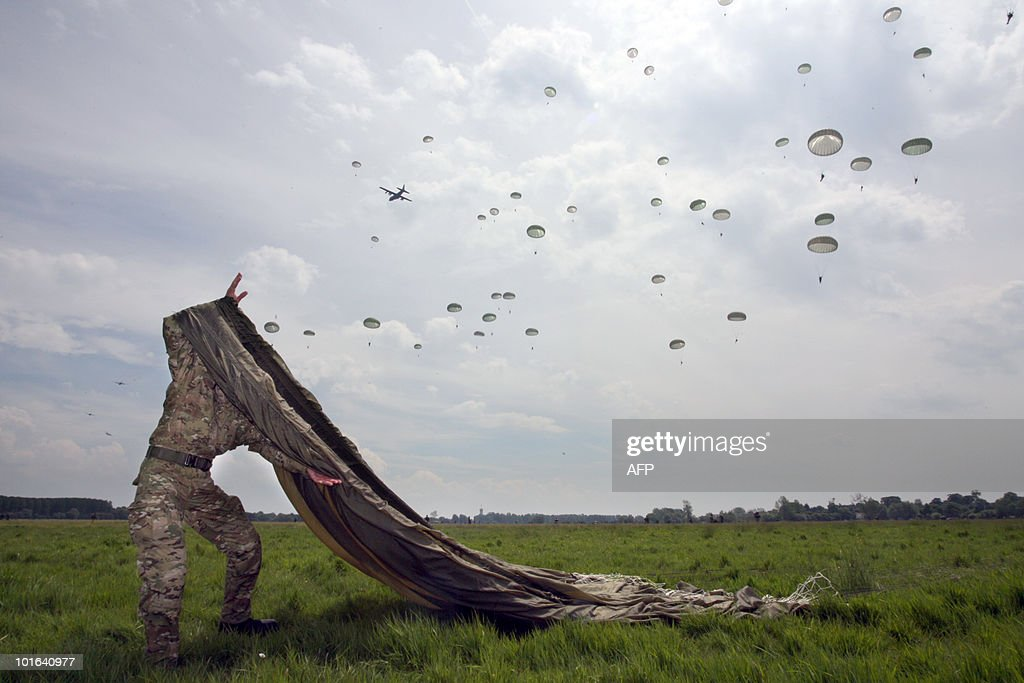 Parachutists are landing on June 5, 2010 near Sainte-Mere-Eglise, during the D-Day celebrations to mark the 66th anniversary of the June 6, 1944 allied landings in France. AFP PHOTO KENZO
