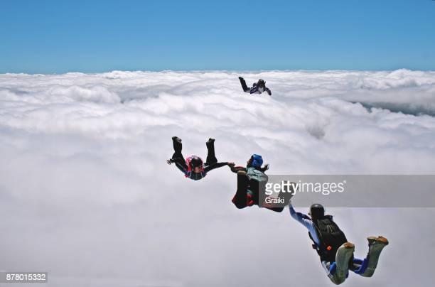 Parachutists having fun above the clouds.