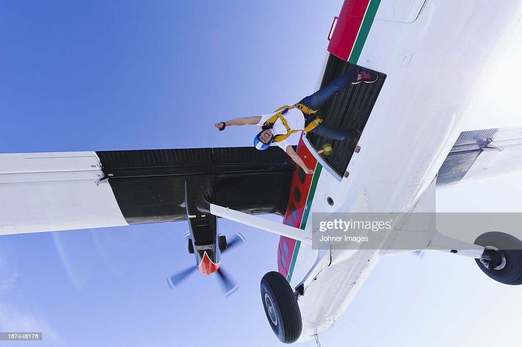 Parachutists jumping from airplane : Stock Photo