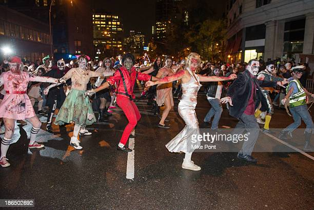 Parade attendees perform Michael Jacksons Thriller in the New York City 40th Annual Village Halloween parade on October 31 2013 in New York City
