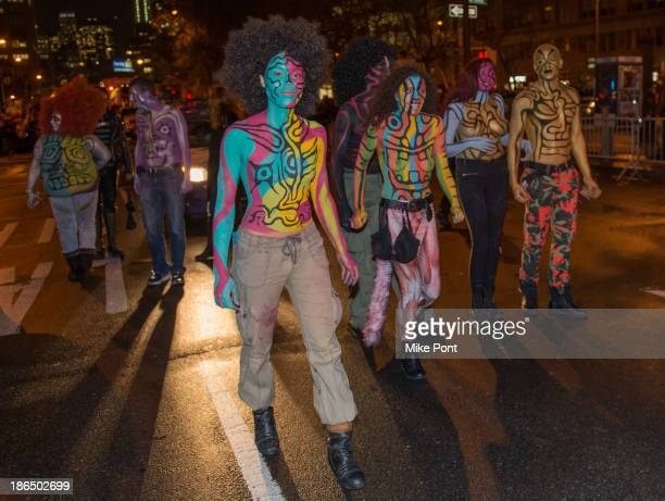 Parade attendees walk in the New York City 40th Annual Village Halloween parade on October 31 2013 in New York City