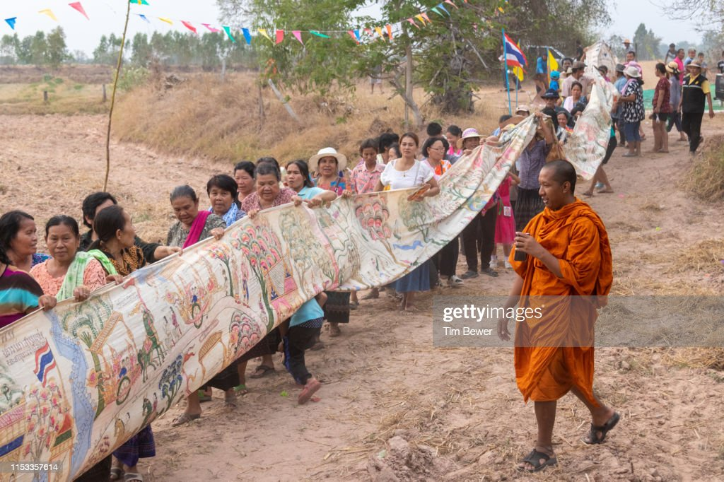 Parade back to the temple for Boon Pha Wet festival. : Stock Photo