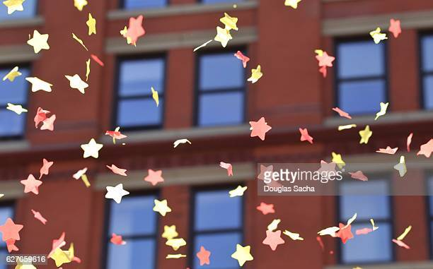parade confetti falls from the downtown office building - thanksgiving parade stock photos and pictures