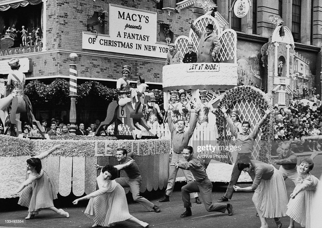 A parade float advertising the Broadway musical 'Let It Ride' during the Macy's Day Parade at Thanksgiving in New York City, 26th November 1961. The sign behind reads 'Macy's Presents a Fantasy of Christmas in New York'.