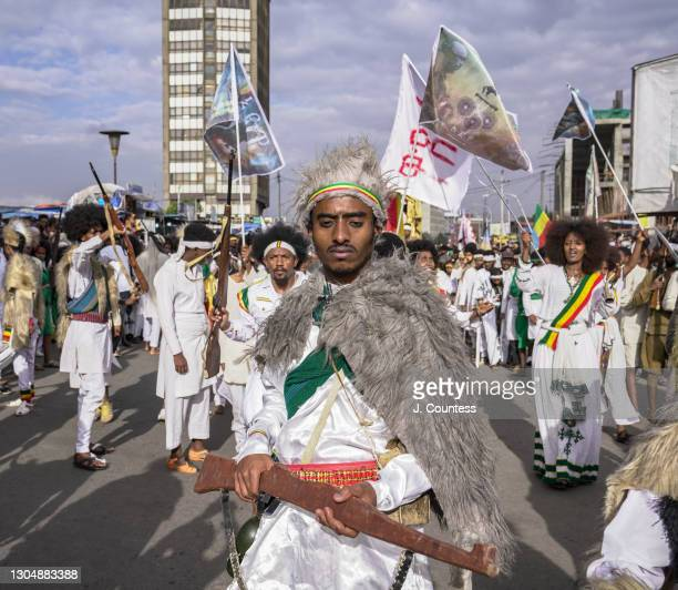 Parade goer dressed as a soldier of the day leads a procession to Saint George Church as Ethiopians celebrate the victory at the Battle of Adwa on...