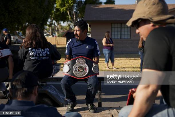A parade goer holds a boxing tite belt before the start of a homecoming parade in honour of Heavyweight boxing champion Andy Ruiz Jr on June 22 2019...