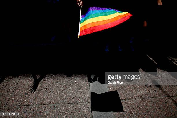 A parade goer waves a flag during 43rd annual San Francisco Lesbian Gay Bisexual Transgender Pride Celebration Parade June 30 in San Francisco...