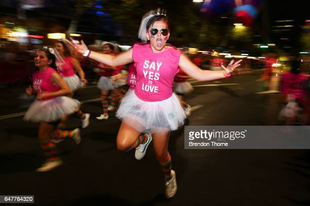Parade goers dance during the 2017 Sydney Gay Lesbian Mardi Gras Parade on March 4 2017 in Sydney Australia The Sydney Mardi Gras parade began in...