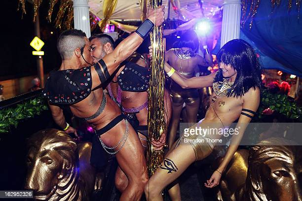 Parade goers dance during the annual Sydney Gay and Lesbian Mardi Gras Parade on March 2 2013 in Sydney Australia Thousands of spectators gathered to...