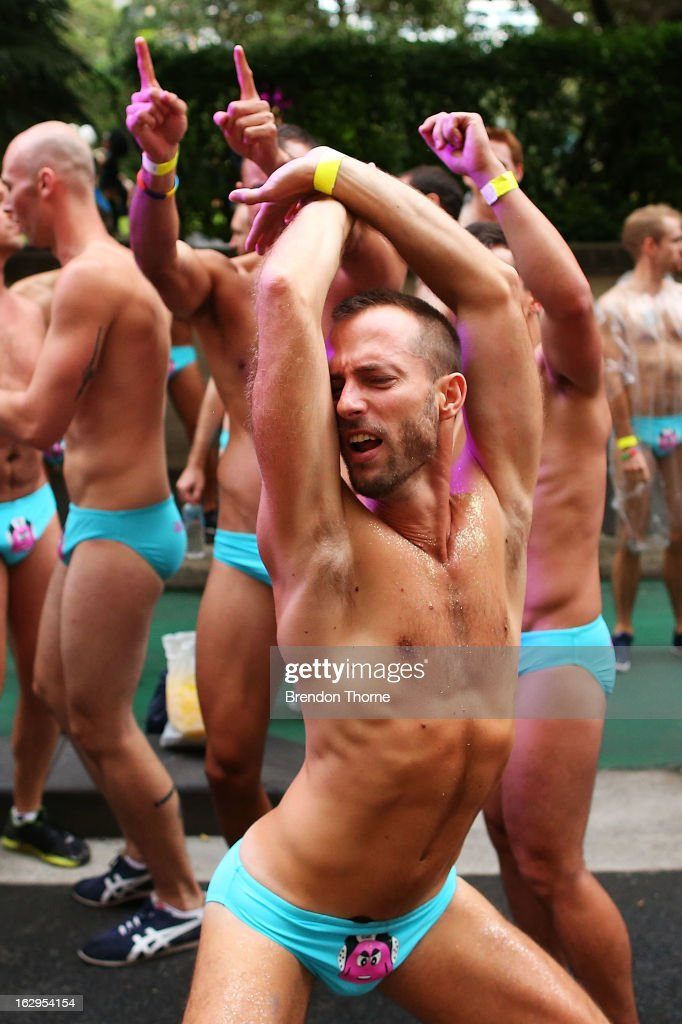 Parade goers dance prior to the start of the annual Sydney Gay and Lesbian Mardi Gras Parade on March 2, 2013 in Sydney, Australia. Thousands of spectators gathered to watch the 35th annual parade held in celebration of the gay, lesbian, bisexual and transgendered community.