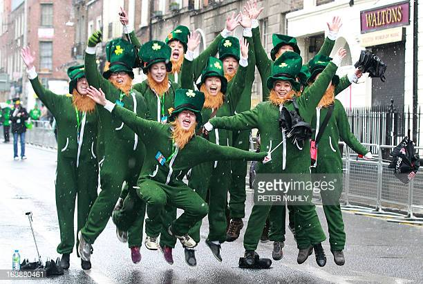 Parade goers dressed as leprechauns jumps up and shout as they prepare to attend St Patrick's Day festivities in Dublin on March 17 2013 More than...