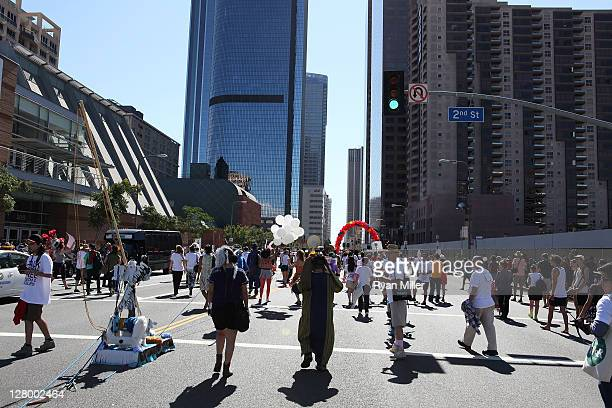 Parade goers during the Trespass Parade through downtown Los Angeles and ending at the Museum of Contemporary Art to celebrate Pacific Standard Time:...