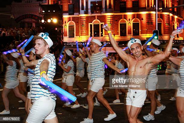 Parade goers make their way along Oxford Street during the 2015 Sydney Gay Lesbian Mardi Gras Parade on March 7 2015 in Sydney Australia The Sydney...