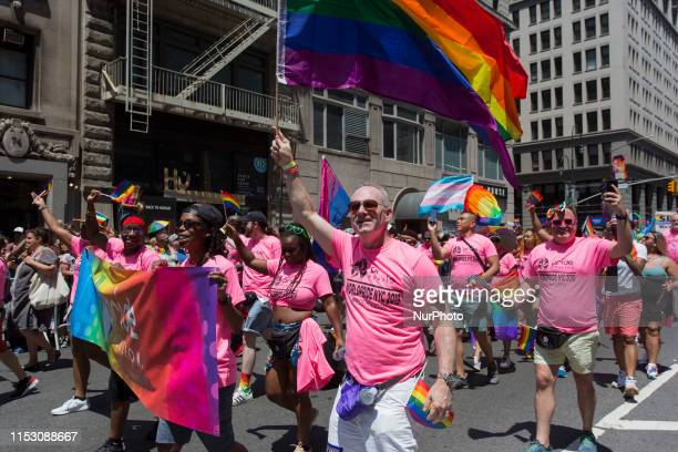 Parade goers march at the annual Pride Parade on Sunday, June 29, 2019 in New York, NY. This years annual Pride Parade celebrates the 50th...