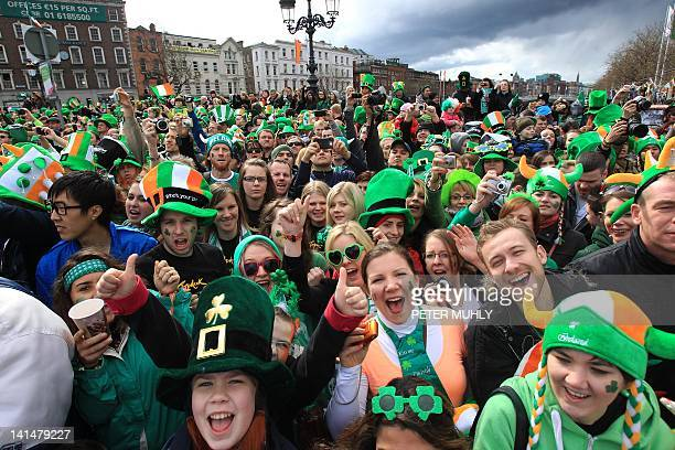 Parade goers shout as they watch St Patrick's Day festivities in Dublin Ireland on March 17 2012 More than 100 parades are being held across Ireland...