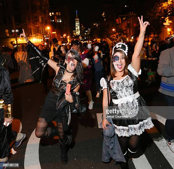 Parade goers walk in the 42nd Annual Village Halloween Parade on October 31 2015 in New York City