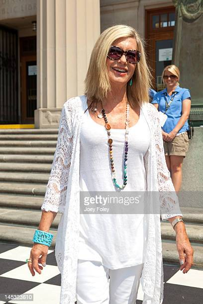 Parade Grand Marshal Olivia NewtonJohn attends the IPL 500 Festival Parade on May 26 2012 in Indianapolis Indiana