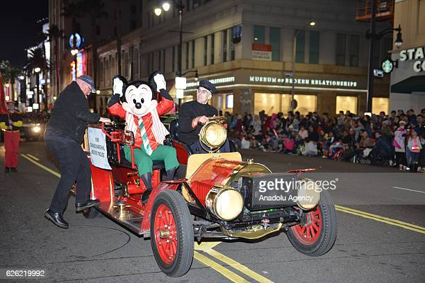 Parade grand marshall Mickey Mouse waves to the crowd during the 85th Hollywood Christmas Parade in Hollywood CA United States on November 27 2016...
