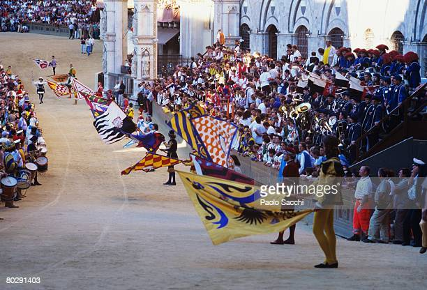 parade in siena during the palio festivities. italy - siena italy stock pictures, royalty-free photos & images