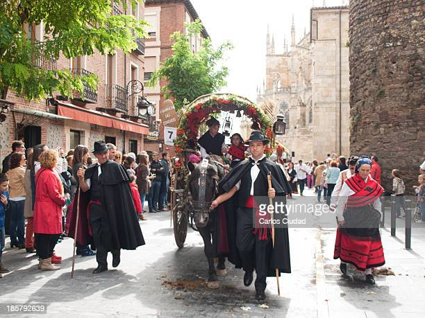 Parade of decorated carts during San Froilan Festival in Leon. More than 90 carts decorated with flowers and local products go all over the city on...