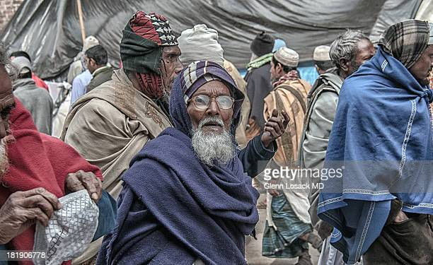 CONTENT] Parade of devotees during IJTEMA the second largest HAJJ next to Mecca Tongi Bangladesh Elderly muslim man with eyeglasses featured
