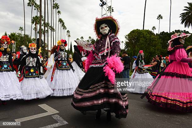 parade of masked, painted and costumed dancers celebrate day of the dead at hollywood forever cemetery in los angeles, california, usa - day of the dead festival stock photos and pictures