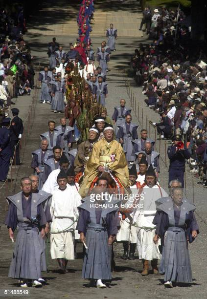 Parade of participants dressed in traditional costume takes part in the Autumn Festival at Toshogu Shrine in Nikko, in Tochigi prefecture, some 145...