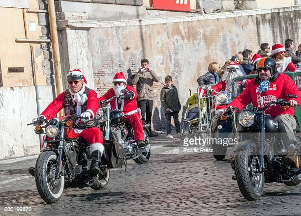 Parade of Santa Claus on motorcycles through the streets of central Rome for a bike solidarity Epiphany with stops at People's Square Venice square...
