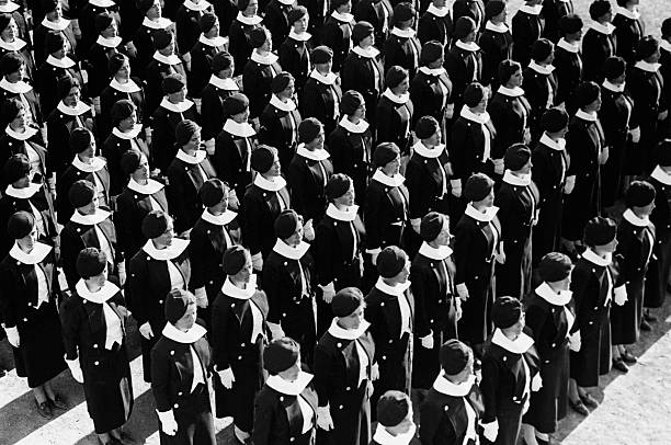 A parade of the Giovani Italiene a fascist organization for young women Italy ca 1935