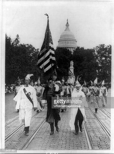 Parade of the Ku Klux Klan in regalia and carrying the stars and stripes through counties of Virginia bordering on the District of Columbia America...
