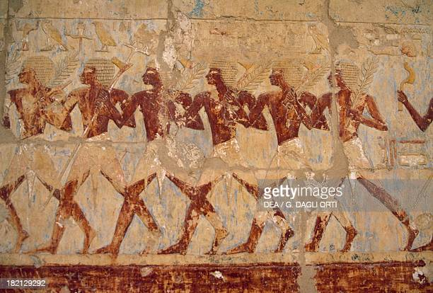 Parade of the Queen's soldiers in honour of the goddess Hathor painted relief Chapel of Hathor Mortuary Temple of Hatshepsut Deir elBahari Theban...