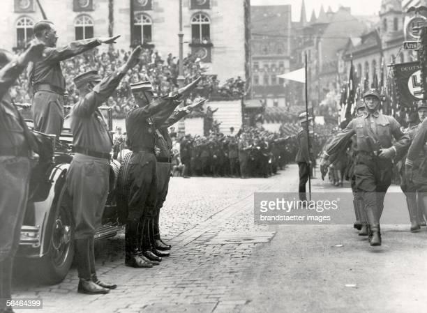 Parade of the SA . Soldiers are passing Adolf Hitler at the Reichsparteitag . Photography. 1937. [Vorbeimarsch der SA an Adolf Hitler waehrend des...