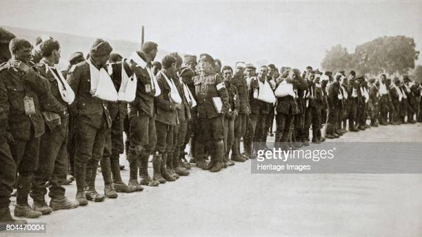 A parade of the walking wounded Somme campaign France World War I 1916 Artist Unknown