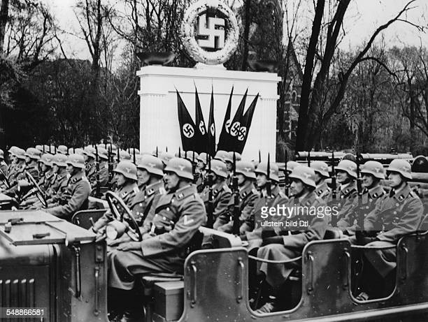Parade of the Wehrmacht on the eastwest city axis in Berlin antiaircraft units passing by in open trucks Photographer Heinz Fremke Published by...