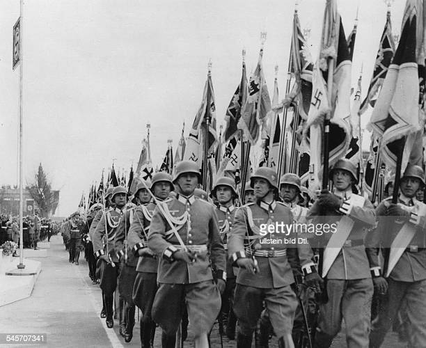Parade of the Wehrmacht on the OstWestAchse in Berlin on Hitler's 50th birthdayFlag Company marching past the VIP stand